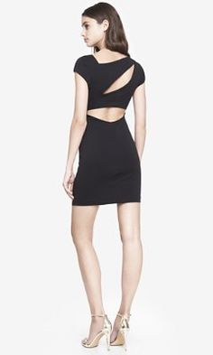 This ASYMMETRICAL CUT-OUT BACK DRESS - BLACK from EXPRESS is business in the front, party in the back