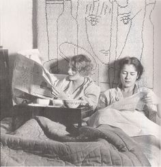 Lee Miller and Tanja Ramm in Miller's Paris studio having breakfast in bed in the company of a wall hanging by Jean Cocteau, Theodor Miller, c1929.