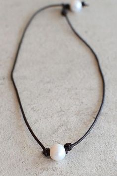 Chokers are in right now so it's only right you sport the latest trend right? This brown leather chocker is adorned with two statement pearls held in place by leather knots. Wear around your neck with