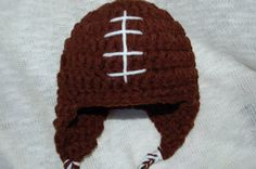 READY TO SHIP  Size: 0-3 months *Other sizes available by custom request   Your baby will look great when you go over to your friends house to watch the game! This hat is made with double strand, dark brown yarn for extra warmth. I embroidered laces on the front to make it look authentic! This would make a great gift at a baby shower, birthday gift, or just a gift to an expectant mother to say I was thinking of you!  I hope as you are looking at my shop, my items reflect what Psalm 127:3…