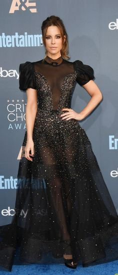 Who made  Kate Beckinsale's black gown, shoes, jewelry, and purse?
