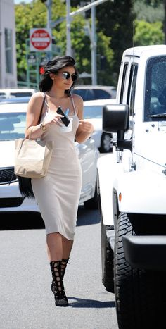 Kylie Jenner channeled the '90s with a modern twist when she slipped into a tank dress and statement boots.
