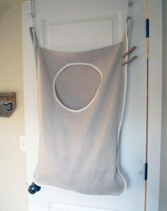 Having a hamper in every room where clothes get taken off has really cut down the number of clothes that end up on the floor. But what family wants to give up precious bedroom space for multiple hampers? Solution: hang them on the back of the door!