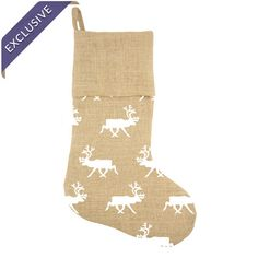 Burlap stocking with a reindeer motif in white. Handmade in the USA.  Product: StockingConstruction Material: Bu...