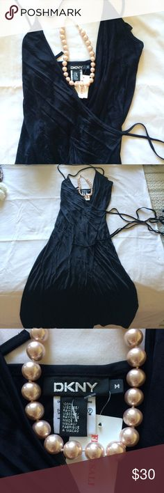 DKNY Wrap Dress New with tags • size medium • black satiny material • has a spot where the string can come through on the inside to wrap around the waist • lovely, feminine silhouette • 💕🎀🛍 sabineforever.com for style, beauty and lifestyle finds DKNY Dresses