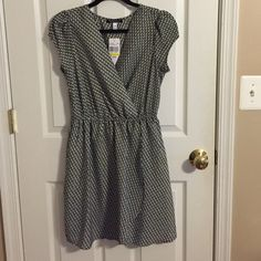 NWT black and white printed dress size M Black and white crossover dress with slip underneath. No trades. Xtraordinary Dresses