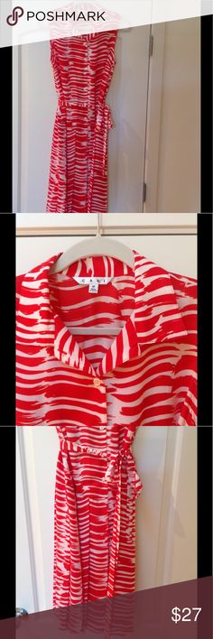 "Gorgeous CAbi brushstroke dress, EUC, size medium This gorgeous coral-red CAbi brushstroke print dress is in mint condition. Size medium.  Approximate measurements laying flat:  shoulder to hem 43""....shoulder to shoulder 14""....bust (pit to pit) 18""... waist 19""....drop waist 20"". Low maintenance machine washable! CAbi Dresses"