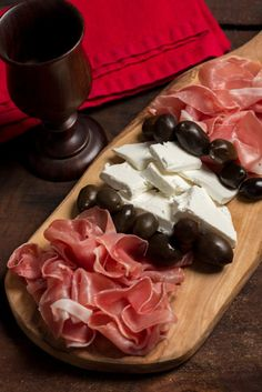 Montenegrin Prsut (Dry-cured ham with cheese and olives)