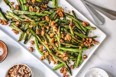 Charred Sesame Pecan Green Beans | Chicago Sun-Times. Make this delicious side dish at home using Maruhon Toasted sesame oil! #pecan #greenbeans #sesame #sesameoil #Maruhon Toasted Sesame Oil Recipe, Canadian Bacon, Menu Planners, Vegetable Stew, Toasted Pecans, How To Make Salad, Dinner Rolls, Mediterranean Recipes, Popular Recipes