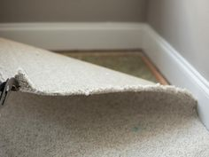 Rid your room of all traces of dated wall-to-wall carpet following these simple steps.