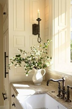 Romantic cottage kitchen . . . def a me look. Like the top.  Prob granite or quartz not marble.   Looks like a matte finish; not polished but has the grey, naturals, creams & browns that are very suited to this house.