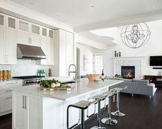 Open kitchen living room design w dark hardwood floors,  crisp, clean white lines and stainless steel appliances #home #remodel #kitchen #bathroom #interiors