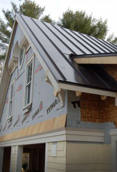 standing seam black metal roof.  Good looking, and no more shoveling on the roof.