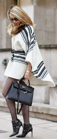 Cape Trend 2015: Caroline Louis is wearing a black and white cape from Zara