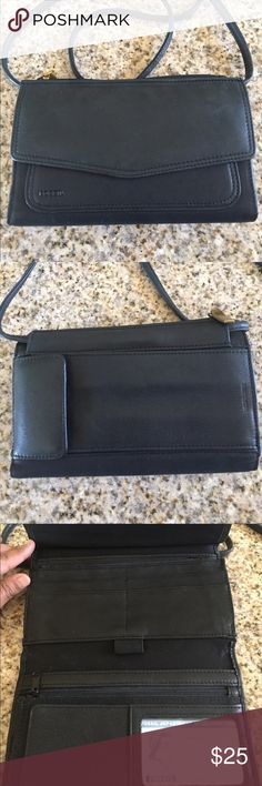Fossil Wallet Purse Fossil wallet purse. It's a wallet style but has a removable strap. Stores plenty of cards, checkbook, and even some small items such as chapstick, car keys, and sunglasses. Fossil Bags Crossbody Bags