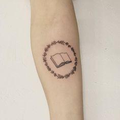 Book with rosemary wreath tattoo - Tattoo People Toronto - Jess Chen