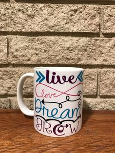 A personal favorite from my Etsy shop https://www.etsy.com/listing/505105105/live-love-dream-grow-coffee-mug