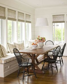 Love the bench. Maybe under dining room window,then table can be pushed in to save space.