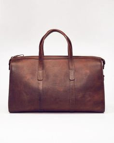 """DESCRIPTION    Inspired by the freedom of the weekend, our essential travel bag will collect your stories with age and last a lifetime. Handmade with vegetable tanned leather in a state of the art facility in Leon, Mexico.   PRODUCT DETAILS    11"""" H x 19.75"""" L x 8.5"""" D Adjustable Strap: 45"""" - 49"""" L Vegetable-tanned leather constructionDual carry handles Adjustable over-the-shoulder strap Interior zipper pocket and canvas compartment Lined with tan cotton canvas Leather zipper pulls Handmade…"""
