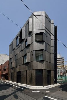 Angled fins flanks the windows of this Tokyo apartment block.: