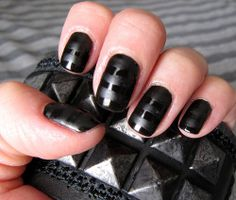 "One coat OPI's ""Black Onyx"", one coat Seche Vite Topcoat, then used a thin brush to make matte stripes using Essie's ""Matte About You"" topcoat."