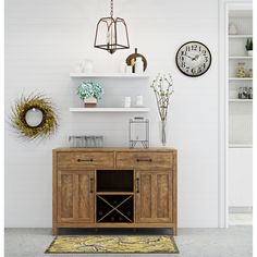 Modern entertainment meets mid-century design in this rustic Avenal Sideboard. Each piece is uniquely characterized by natural color variations and hand finishing techniques reminiscent of the reclaimed look. Simplistic style lends way to ample storage of life's most important necessities whether it be stemware, spirits or otherwise.