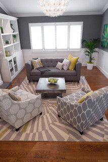 gray walls, white paneling, white built-ins, tufted sofa, coordinating fabrics on chairs + rug
