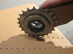 cardboard scoring wheel- from bike parts