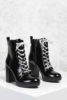 A pair of faux leather ankle boots featuring a lace-up front with contrast laces and high-polish grommets, an almond toe, a chunky stacked heel, side zipper, and a back pull-tab.