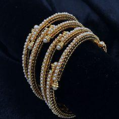 Thin overlapping moti bangles