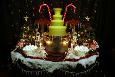 Christmas chocolate fountain table. Use green chocolate coloring oil with white fountain chocolate. For fantastic flavor, use (no oil needed) mouthwatering Belgian style Chocoley Just Melt It! Fountain & Fondue Chocolate (available in semisweet dark, milk & white). Available at http://www.chocoley.com/list/fountain-fondue-chocolate
