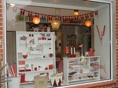 christmas window display use open back shelves for window and in store sight