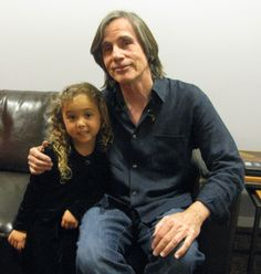 Jackson Browne with a very special young lady.