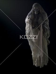 image of a human skeleton with chain. - Image of a human skeleton with chain over black background.