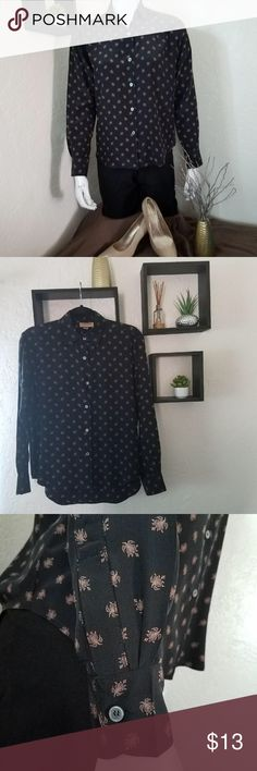 """STANDARD FINERY BLACK BUTTON DOWN SHIRT SIZE 4 USED Standard Finery Black Button down shirt. Flower design . Button on the sleeves. In great condition 100% Silk Size 4 💥MEASUREMENTS💥 •Length: 26"""" •Waist : 20"""" •Pit to Pit: 22"""" •Sleeve: 22"""" standard finery Tops Button Down Shirts"""