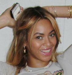 """Beyoncé wearing """"Big Apple"""" earrings from the Fine Jewelry line."""