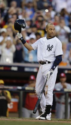 All-Star farewell: Jeter takes bow, hits double - Shortstop Derek Jeter, of the New York Yankees, waves to the crowd during the first inning of the MLB All-Star baseball game, Tuesday, July 15, 2014, in Minneapolis. (AP Photo/Jeff Roberson)