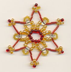 Star 14 - red and gold by pralinkova-princezna on DeviantArt Beaded Christmas Ornaments, Snowflake Ornaments, Beaded Jewelry Patterns, Beading Patterns, Beading Jewelry, Pearl Decorations, Christmas Decorations, Alcohol Ink Crafts, Girly