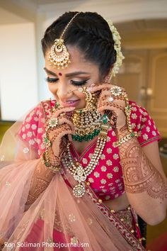 Lovely indian bride putting bridal jewelry https://www.maharaniweddings.com/gallery/photo/145348