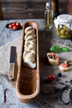 Hand crafted ash wood board for cutting and serving baguette