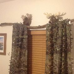 My camo-crazy son's curtain and curtain rod. The rod is a branch I picked up out of the yard. Covered the branch with polyurethane. Curtains are hunting blind covering that I found at Bass Pro.