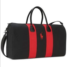 Polo By Ralph Lauren Duffle Brand new!! In its original packaging. Black and red with its signature logo in the middle from their limited addition fragrance collection. Fully lined , Canvas duffle bag. Comes with shoulder strap, faux leather handles and also bottom, zipper closure . Polo by Ralph Lauren Bags Travel Bags