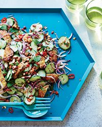 Get Food & Wine's Grilled Chicken Thigh and Cucumber Salad recipe from star chef Michael Symon.