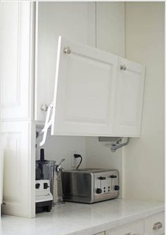 I want to show you all the creative hidden kitchen storage solutions I came up w. - I want to show you all the creative hidden kitchen storage solutions I came up with and how they make my life so much easier. I LOVE cooking in my kit. Farmhouse Kitchen Cabinets, Kitchen Redo, Ikea Kitchen Remodel, Small Kitchen Cabinets, Kitchen Must Haves, Decorating Kitchen Counters, Kitchen Wall Decorations, Kitchen Cabinets Fittings, Kitchen Microwave Cabinet
