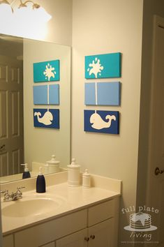 Full Plate Living: Whale of a Project  Love this idea! She used paint and canvas, but I would use fabric or scrapbook paper and Mod Podge!