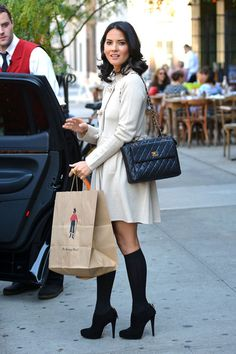 Olivia Munn, wearing knee high socks, is seen climbing into a waiting car whilst leaving The Bowery Hotel