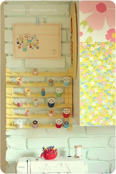 """I remember my mom's sewing station had a spool """"shelf""""...i think it actually was just nails for spindles. :)"""