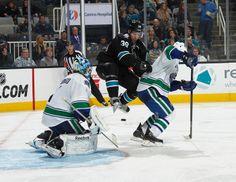 San Jose Sharks forward Logan Couture jumps to avoid a shot on goal (Nov. 7, 2013).