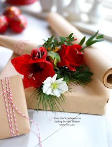 Gift wrap with live flowers.  Gorgeous.