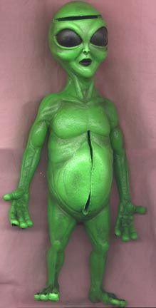 """1997 Alien Autopsy doll  -14"""" tall  he is very heavy with a slit in his tummy and in his head that open to hollows in the inside, holding loose body parts . ©1997 R. Marino/Made in China""""   He is Very Rare and really cool."""
